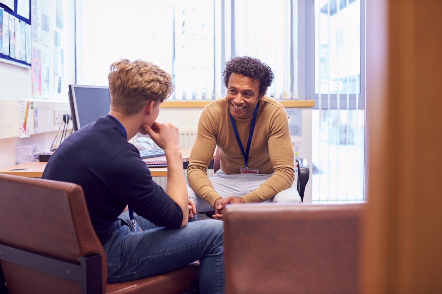 Male College Student Meeting With Campus Counselor
